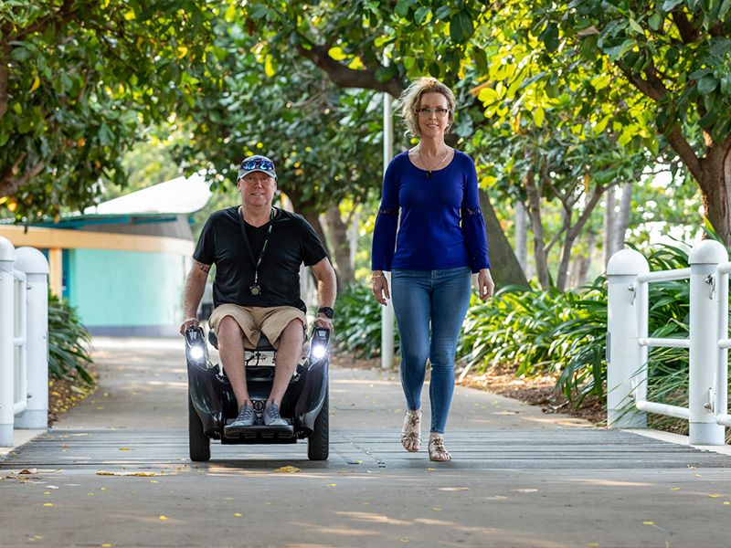 Jeff on his Omeo walking with his wife